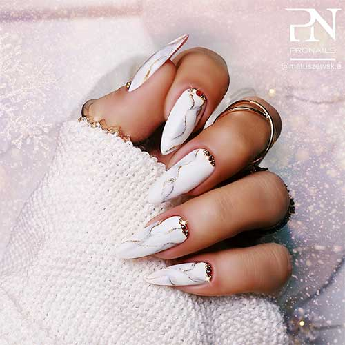 white marble almond nails long with rhinestones on cuticle area