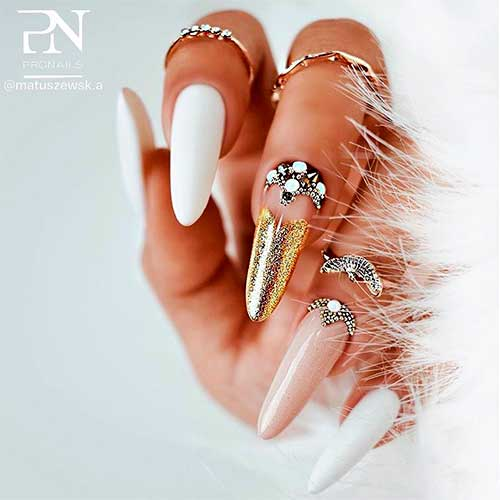 Matte white almond nails with gold with rhinestones and two accent gold glitter and nude color nails