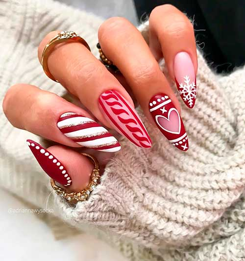 Cute almond shaped pink and red Christmas nails 2020 with two accent candy cane and snowflake nails idea for celebration!