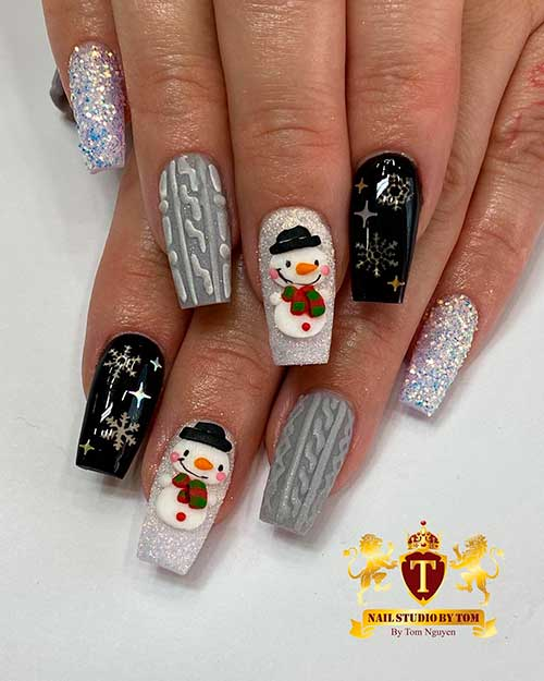 Cute little snowman Christmas nails 2020 with accent glitter nail, accent sweater nail, accent black snowflake nail design!