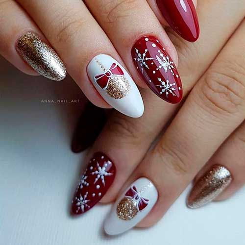 Cute red white snowflake nails 2020 almond shaped with two accent Christmas balls and gold glitter nails design!