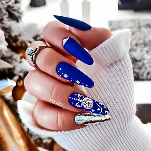 Gorgeous long almond matte royal blue Christmas nails 2020 with accent silver nail and rhinestones.