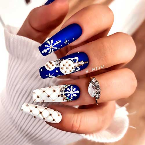 Stunning velvet blue cobalt colored coffin nails with white snowflakes and two accent quilted white nails for Christmas 2020!